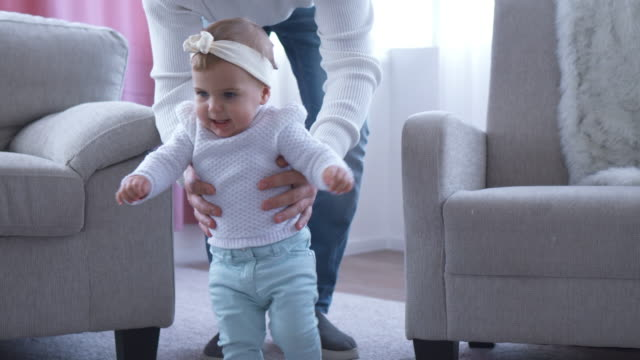 pretty daughter learning to walk going to mother - baby girls stock videos & royalty-free footage