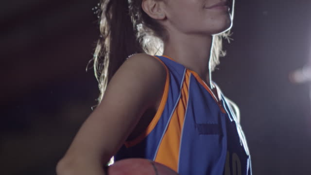Pretty female basketball player smiling at camera