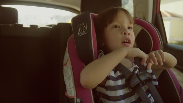 pretty girl in a child car seat - back seat stock videos and b-roll footage