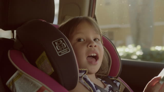 pretty girl in a child car seat - baby carrier stock videos & royalty-free footage