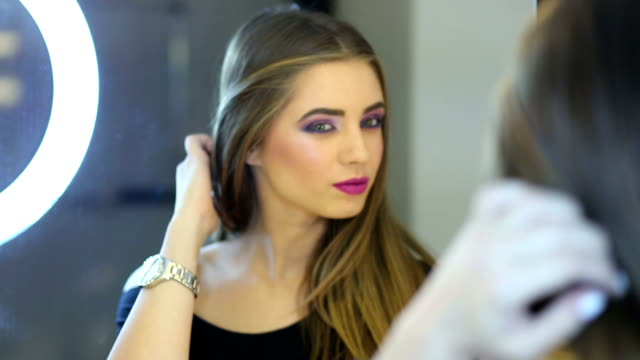 pretty girl in front of the mirror corrects her makeup - blusher make up stock videos and b-roll footage