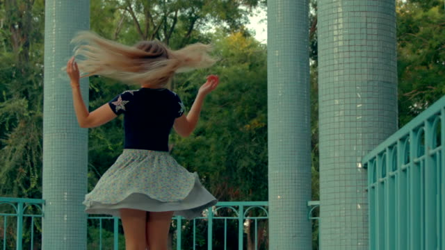 pretty girl in skirt swirling between columns - skirt stock videos & royalty-free footage