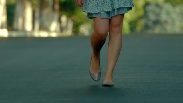pretty girl in skirt walking towards the camera. slow motion - skirt stock videos & royalty-free footage