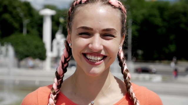pretty girl smiling at the camera - pigtails stock videos & royalty-free footage