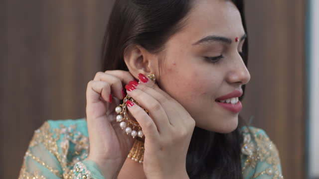 pretty lady gets ready for the greatest moment in her life party wedding engagement proposal bride love earrings - bride stock videos & royalty-free footage