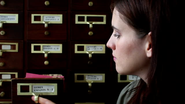 pretty librarian at card files - librarian stock videos & royalty-free footage