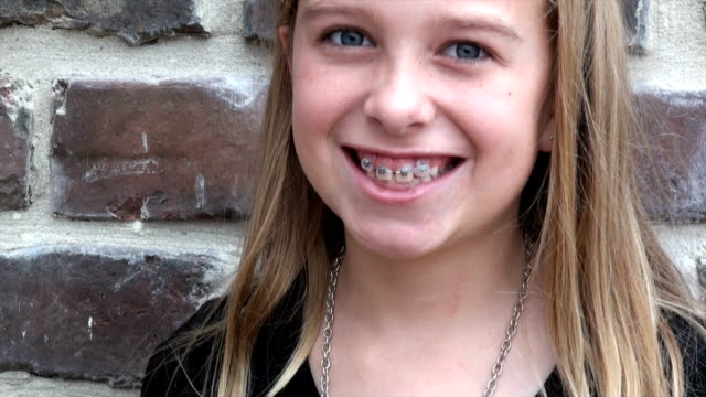 pretty little girl after braces - brace stock videos and b-roll footage