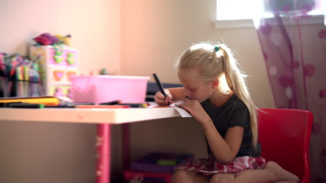 pretty little girl drawing in the kids room - human face drawing stock videos & royalty-free footage