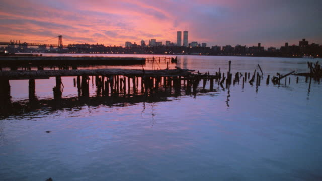a pretty pink and purple sky glows above the hudson river near new york city. - 2001 stock videos & royalty-free footage