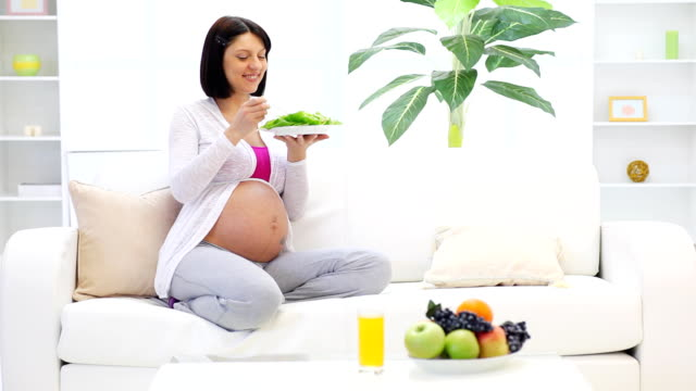 pretty pregnant woman eating vegetable salad. - salad stock videos & royalty-free footage