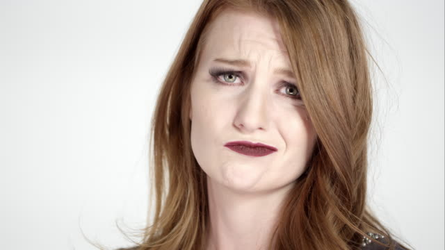 pretty red head woman making a sad face - raised eyebrows stock videos and b-roll footage