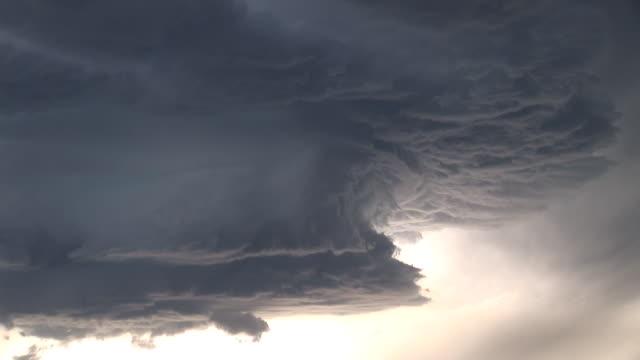 Pretty Supercell storm zooms out from swirl of clouds, severe thunderstorm, WA, USA