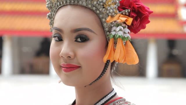 a pretty thai dancer poses with her headdress. - headdress stock videos & royalty-free footage