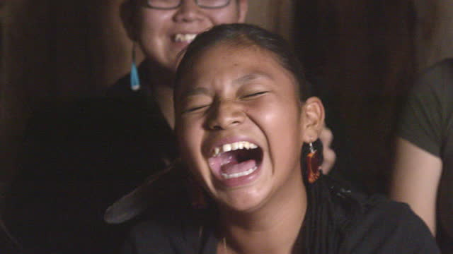 pretty thirteen-year-old navajo native north american girl in a hogan as the brothers and sisters has fun together - indigenous north american culture stock videos & royalty-free footage