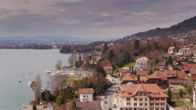 pretty towns on lake thun, switzerland - lake thun stock videos and b-roll footage