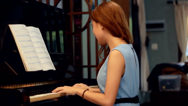 pretty woman composing music - sheet music stock videos & royalty-free footage
