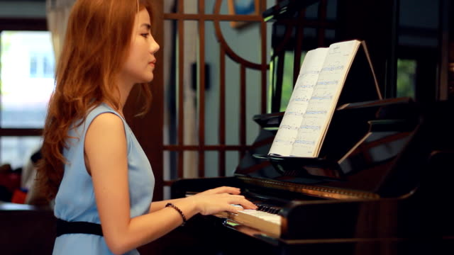 pretty woman composing music - piano stock videos & royalty-free footage