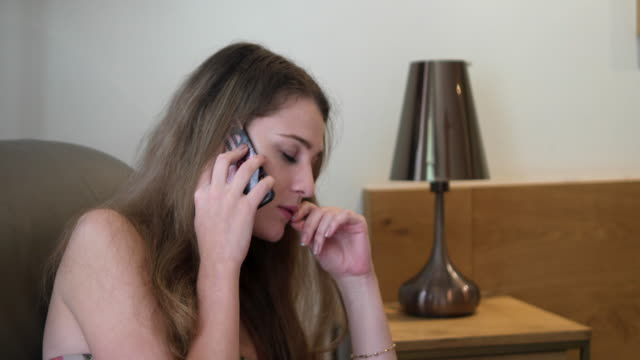 Pretty woman dissappointed after a phone call