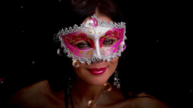Pretty woman in a mask. Lightness and grace