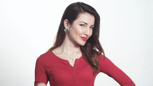 vídeos y material grabado en eventos de stock de pretty woman showing ok sign with fingers - esmalte de uñas rojo