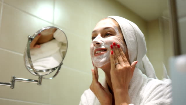 pretty women applying a facial mask - washing stock videos & royalty-free footage