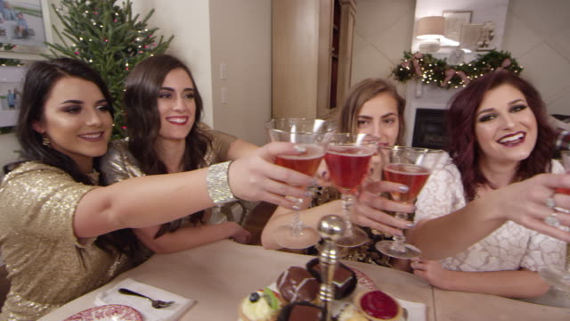 stockvideo's en b-roll-footage met pretty women toasting at a holiday christmas party - martiniglas