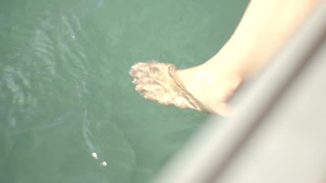 vídeos y material grabado en eventos de stock de pretty young adult female in bikini sunbathing - pie humano