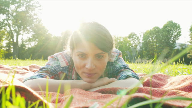 pretty young girl relaxing on grass. - lying on back stock videos and b-roll footage