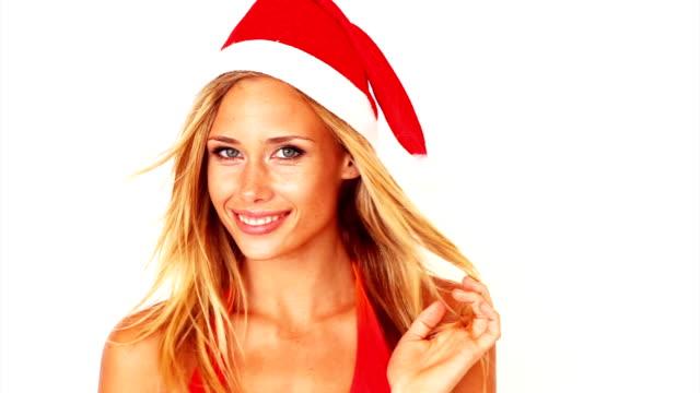 pretty young girl wearing santa hat - santa hat stock videos & royalty-free footage