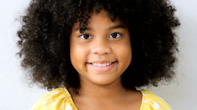 pretty young latina girl cute hispanic female child smiling - curly stock videos & royalty-free footage