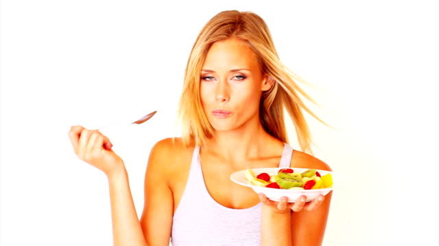 pretty young woman eating fruit salad - fruit salad stock videos & royalty-free footage