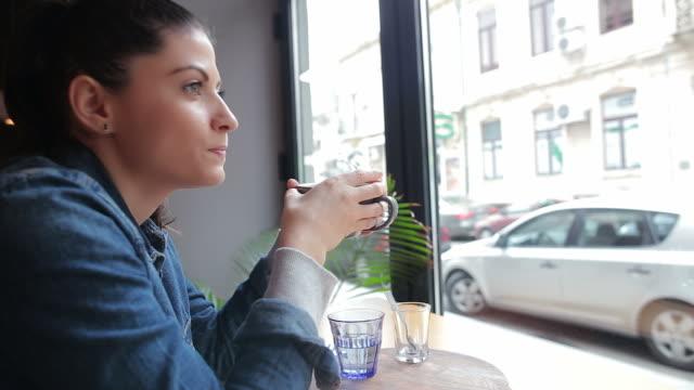 Pretty young woman enjoying her coffee in beautiful morning.