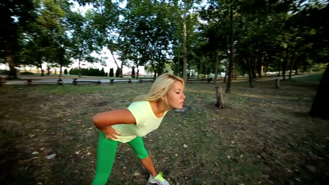 Pretty young woman having exercise outdoors,camera stabilization shoot