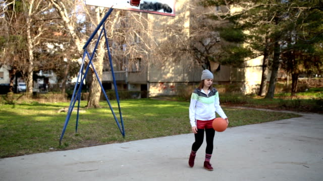 pretty young woman shooting hoops - courtyard stock videos and b-roll footage