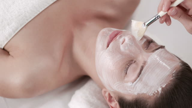 hd: pretty young woman with facial mask - beautician stock videos and b-roll footage