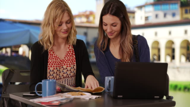 pretty young women using laptop computer to check maps by ponte vecchio bridge - ponte stock videos & royalty-free footage