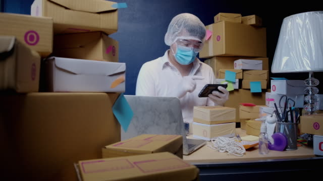 prevent germs from the postal parcel delivery by wearing protective clothing - freight transportation stock videos & royalty-free footage