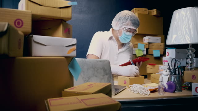 prevent germs from the postal parcel delivery by wearing protective clothing - guanto indumento protettivo video stock e b–roll