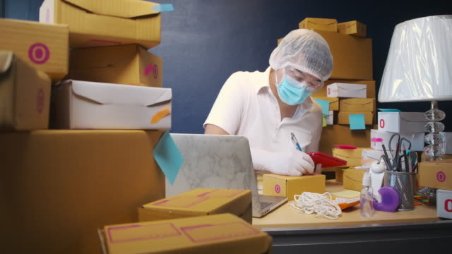 prevent germs from the postal parcel delivery by wearing protective clothing - medical supplies stock videos & royalty-free footage