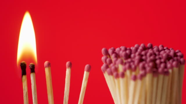 preventing the spread of infectious diseases - break pandemic - burning matchstick, red background - epidemia video stock e b–roll