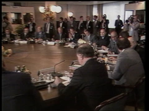stockvideo's en b-roll-footage met prevention of terrorism act tx 41285 itn french pres francois mitterand sitting at euro summit pull out as irish for sec brian lenihan seated with... - top vergadering