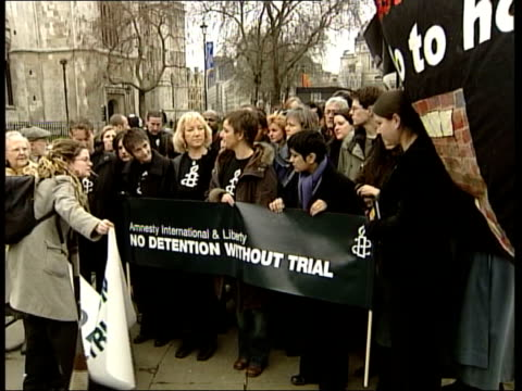prevention of terrorism bill: proposals debated; houses of parliament tilt down to human rights protestor sitting in an armchair locked in a cage... - human back stock videos & royalty-free footage