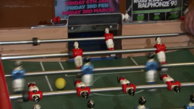 Preview of FA Cup Final between Arsenal and Chelsea ENGLAND London INT Various shots of group of men playing table football Tim Rolls interview SOT...