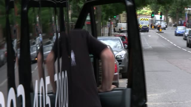 Preview of final England vs Australia ashes test at the Oval ENGLAND London EXT Setup shots of Brendan John getting into cab of his van and driving...