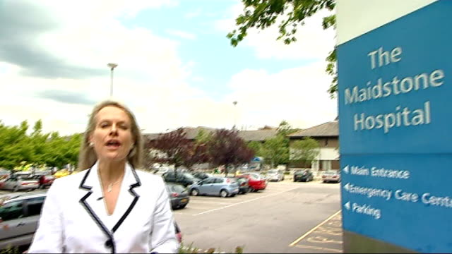 preview of government meeting on topup health payments kent maidstone ext sign for 'the maidstone hospital' pan to reporter to camera - maidstone hospital stock videos and b-roll footage