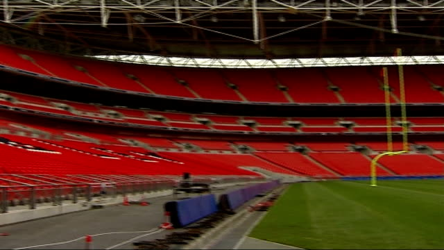 preview of match between new york giants and miami dolphins; t24100742 england: london: wembley stadium: ext empty stadium to goal post low angle... - nfc east stock videos & royalty-free footage