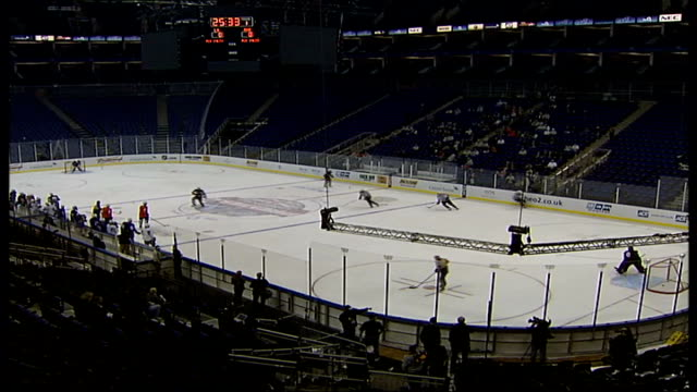 Preview of opening match of US National Hockey League at O2 Arena O2 Stadium INT Various shots of ice hockey players practising on rink