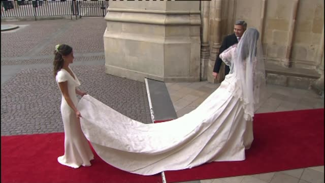 Preview of Pippa Middleton and James Matthews wedding LIB / 2942011 Westminster Abbey Various shots of Pippa Middleton holding dress of Kate...