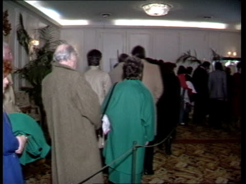 preview of sale of windsor jewels a nat geneva ext ms entrance hotel beau rivage / ms foyer / ms public queuing to see jewels pan lr / cms ruby... - bracelet stock videos & royalty-free footage