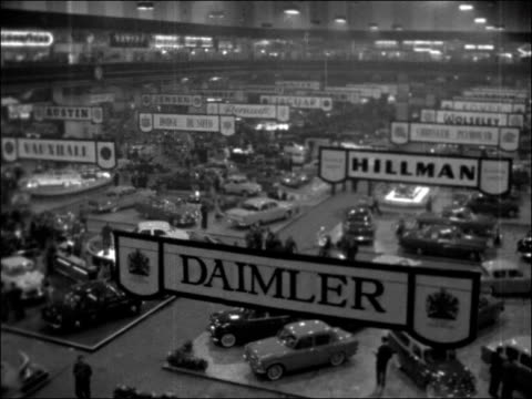 Preview of the 1956 Motor Show at Earl's Court ENGLAND London Earl's Court INT Bentley car on show / General view Lotus 11 / GVs Cresta / Rolls Royce...
